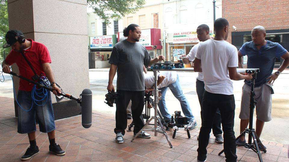Film crew shooting a film on a downtown city street