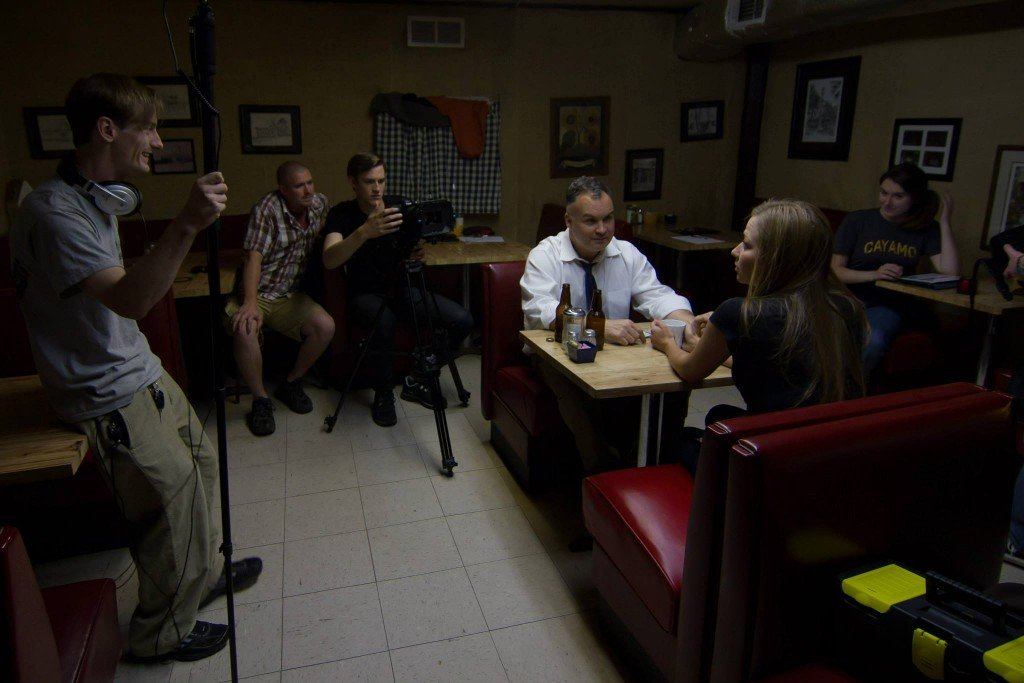 Scene being shot for a movie in a diner using special types of film lighting